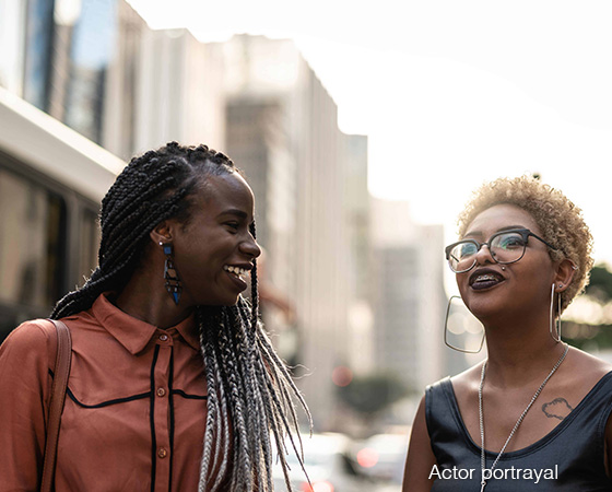 Two women talking on the street.