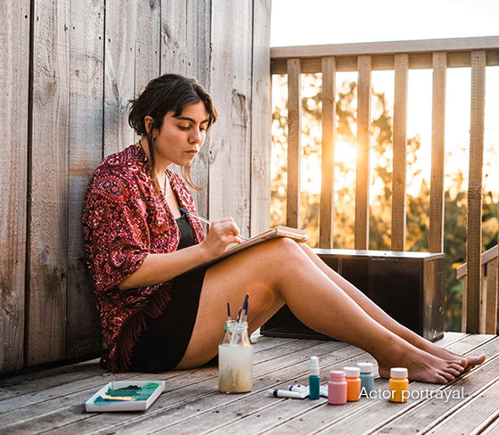 Woman sitting outside painting