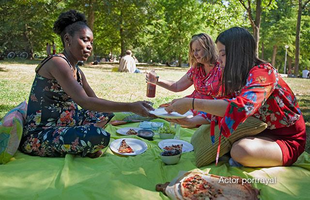 Three female friends enjoying lunch outside