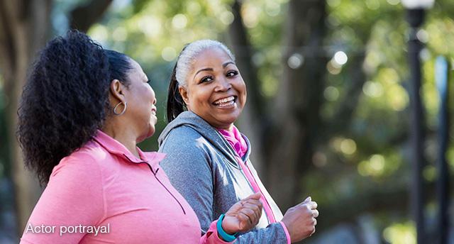 Two women power-walking outside