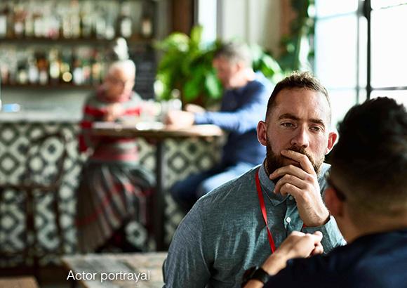 Two men talking at a café