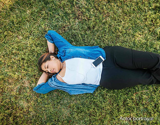 Woman lying outside in the grass